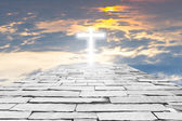 Brick road to a transparent cross giving out heavenly light on t — Zdjęcie stockowe