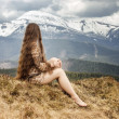 Young woman looking on snowy mount — Stock Photo #53101753