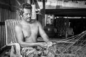 Thai fishermen mending his fishing net on Koh Kood Island, Thailand — Stock Photo