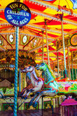 View of Carousel with horses on a carnival Merry Go Round — Stock Photo