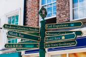 Closeup on tourist Sign posts in city of York, UK.York is a historic walled city at the confluence of the Rivers Ouse and Foss in North Yorkshire, England — Stock Photo