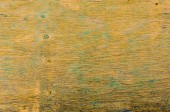 Weathered yellow wood with peeling paint — Foto Stock