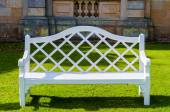 White wooden bench in countryside English park — Stock Photo