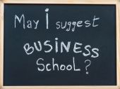 May I suggest Business school message written with white chalk on wooden frame blackboard, business learning concept — Stock Photo