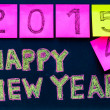 Happy New Year 2015 message hand written on blackboard, numbers stated on post-it notes, 2015 replacing 2014, corporate office celebration concept — Stock Photo #56986421