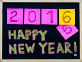 Happy New Year 2016 message hand written on blackboard, numbers stated on post-it notes, 2016 replacing 2015, corporate office celebration concept — Stock Photo