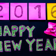 Happy New Year 2016 message hand written on blackboard, numbers stated on post-it notes, 2016 replacing 2015, corporate office celebration concept — Stock Photo #58615963