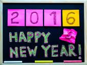 Happy New Year 2016 message hand written on blackboard, numbers stated on post-it notes, 2016 replacing 2015, corporate office celebration concept — Foto de Stock