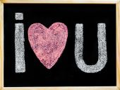 I love you message hand written with chalk on blackboard, word love replaced by heart shape, love concept — Stock Photo