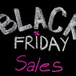 Black Friday sales advertisement handwritten with chalk on blackboard, Black Friday sale concept — Foto Stock #58871373