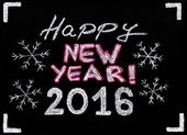 Happy new year 2016, hand writing with chalk on blackboard, isolated on black background, vintage concept — Stockfoto