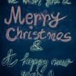 We wish you a Merry Christmas and a happy new year, hand writing with chalk on blackboard, vintage concept — Zdjęcie stockowe #59639265