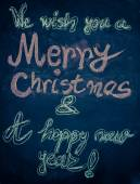 We wish you a Merry Christmas and a happy new year, hand writing with chalk on blackboard, vintage concept — Stock Photo
