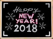 Happy new year 2018, hand writing with chalk on blackboard, vintage concept — Stock Photo