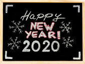 Happy new year 2020, hand writing with chalk on blackboard, vintage concept — Stock Photo
