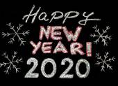 Happy new year 2020, hand writing with chalk on blackboard, vintage concept — Stockfoto