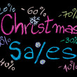 Sales conceptual image with discount figures around Christmas Sales text. Colorful Hand drawing on blackboard, isolated on black background, horizontal shot, holiday sale concept — Stock Photo #60469481
