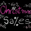 Sales conceptual image with discount figures around Christmas Sales text. Colorful Hand drawing on blackboard, isolated on black background, horizontal shot, holiday sale concept — Stock Photo #60469557