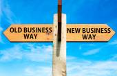 Wooden signpost with two opposite arrows over clear blue sky, Old Business Way and New Business Way, Business change conceptual image — Foto Stock