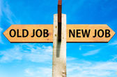 Wooden signpost with two opposite arrows over clear blue sky, Old Job and New Job, Career change conceptual image — Stock Photo