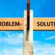 Wooden signpost with two opposite arrows over clear blue sky, Problem versus Solution messages, Problems solving conceptual image — Stock Photo #62521133