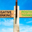 Wooden signpost with two opposite arrows over clear blue sky, Negative versus Positive Thinking messages, Mindset conceptual image — Stock Photo #62545753