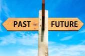 Wooden signpost with two opposite arrows over clear blue sky, Past versus Future messages, Mindset conceptual image — Stock Photo