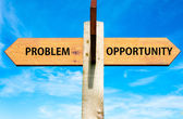 Wooden signpost with two opposite arrows over clear blue sky, Problem versus Opportunity messages, Problems solving conceptual image — Stock Photo