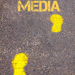 Yellow footsteps on sidewalk towards Social Media message — Stock Photo #66140123