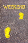 Yellow footsteps on sidewalk towards Weekend message — Stock Photo