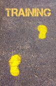 Yellow footsteps on sidewalk towards Training message — Zdjęcie stockowe