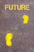 Yellow footsteps on sidewalk towards Future message — Stock fotografie