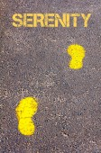 Yellow footsteps on sidewalk towards Serenity message — Fotografia Stock