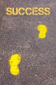 Yellow footsteps on sidewalk towards Success message — Stok fotoğraf