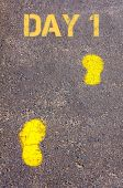 Yellow footsteps on sidewalk towards Day 1 message — Stock Photo