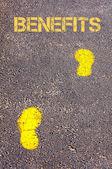 Yellow footsteps on sidewalk towards Benefits message — Stock Photo