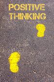 Yellow footsteps on sidewalk towards Positive Thinking message — Stock Photo