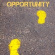 Yellow footsteps on sidewalk towards Big Opportunity message — Stock Photo #66243667