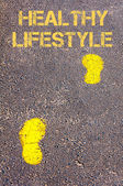 Yellow footsteps on sidewalk towards Healthy Lifestyle message — Stock Photo