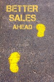 Yellow footsteps on sidewalk towards Better Sales Ahead message — Stockfoto
