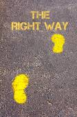 Yellow footsteps on sidewalk towards The Right Way message — Stock Photo