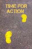 Yellow footsteps on sidewalk towards Time for Action message — Stock Photo