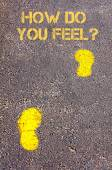 Yellow footsteps on sidewalk towards How do You Feel message — Photo