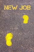Yellow footsteps on sidewalk towards New Job message — Stock Photo
