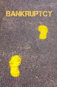 Yellow footsteps on sidewalk towards Bankruptcy message — Stock Photo