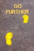 Yellow footsteps on sidewalk towards Go Further message — Stock Photo