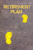 Yellow footsteps on sidewalk towards Retirement Plan message — Foto de Stock