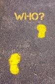 Yellow footsteps on sidewalk towards Who message — Stock fotografie