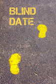 Yellow footsteps on sidewalk towards Blind Date message — Stock Photo