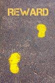 Yellow footsteps on sidewalk towards Reward message — Stok fotoğraf